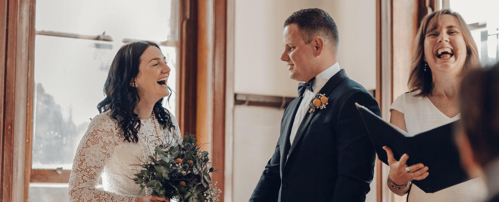 couple laughing wedding ceremony